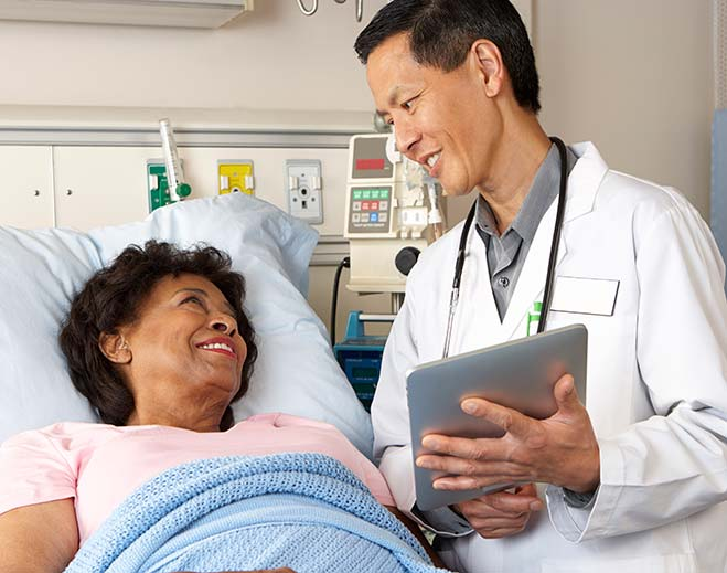 doctor-talking-with-patient-using-tablet